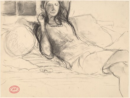 Untitled [woman leaning back on sofa]
