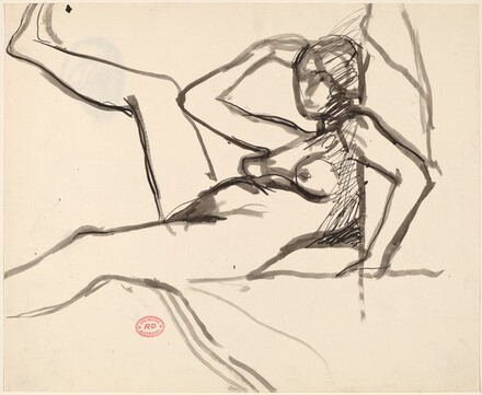 Untitled [reclining female nude with back to wall and leg raised]