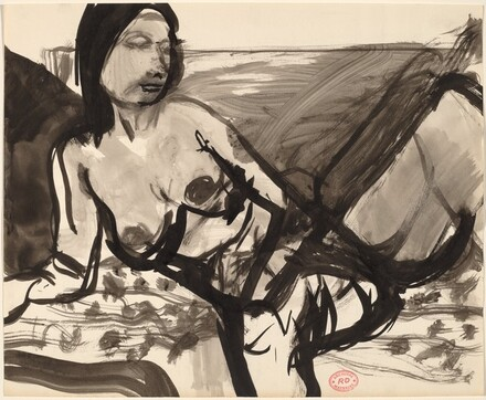 Untitled [female nude resting on a patterned cushion]