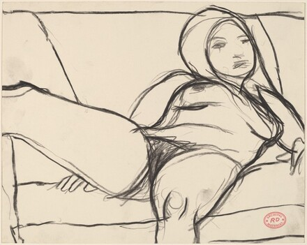 Untitled [female nude reclining on a sofa]