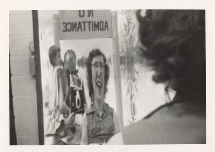 Untitled (Woman looking in distorted mirror)