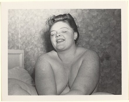 Untitled (Nude woman seated on bed with eyes closed)