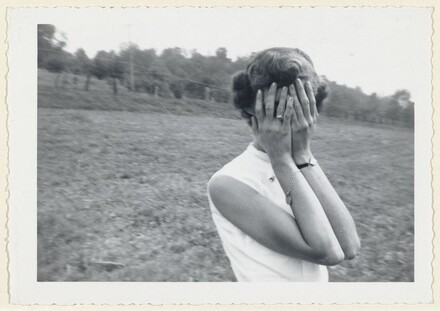 Untitled (Woman with hands over face in field)