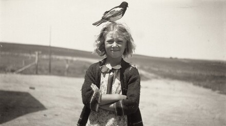 Untitled (Girl with bird perched on top of head)