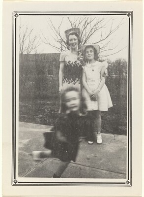 Untitled (Blurred girl in front of woman and girl posing)