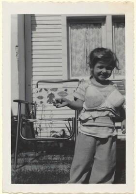 Untitled (Little girl dressing up in bra)
