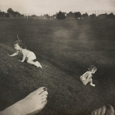 Untitled (Children crawling with bare foot in foreground)