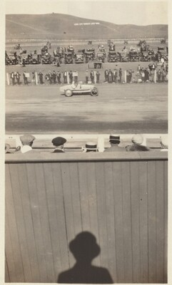Untitled (Shadow of man watching car race)