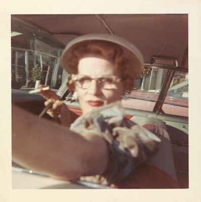 Untitled (Woman with cigarette in car)