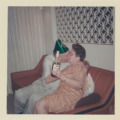 Untitled (Couple kissing with bottle of liquor)