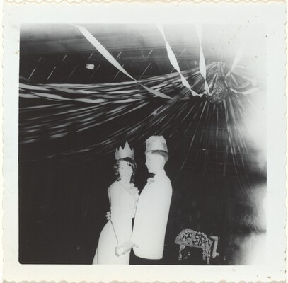 Untitled (Adolescent couple wearing paper crowns at a dance)