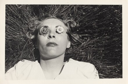 Untitled (Woman lying in grass with metal objects over eyes)