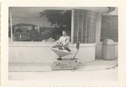 Untitled (Man in toy flying saucer)