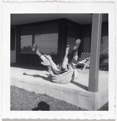 Untitled (Couple falling over on porch)