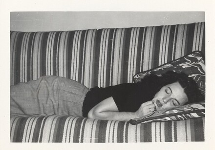 Untitled (Woman asleep on striped sofa)