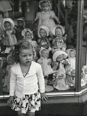 Girl in front of Doll Shop Window