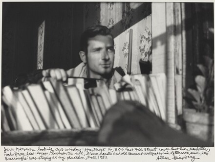Jack Kerouac looking out window Apartment 16, 206 East 7th Street Lower East Side Manhattan, view from fire-escape, books on the sill, broom handle and old tenement wallpaper in afternoon sun, WM. Burroughs was staying at my place then, Fall 1953.
