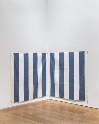 White acrylic paint on white and blue striped cloth