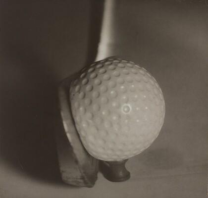 Teeing Off: Club Impacting Ball on Tee