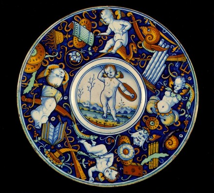 Plate with border of putti and trophies amid grotesques; in the center, a winged putto standing, armed, in a landscape