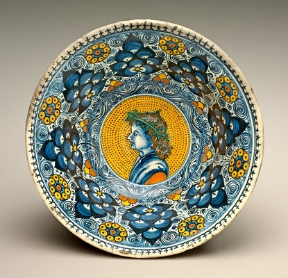 Deep bowl with Persian palmette ornament; in the center, a profile bust of a young man wearing a wreath