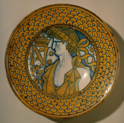 Large dish with scale border; in the center, an imperial Roman figure and the letter N crowned