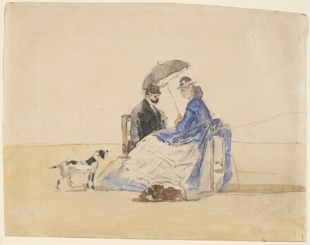 A Couple Seated on the Beach with Two Dogs