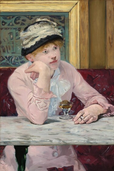 A woman with pale skin sits facing us across a marble-topped table in a café in this vertical painting. Her body is angled slightly to our right and she rests her right elbow, on our left, on the table. She leans her right cheek onto the back of her right hand as she gazes into the distance. She holds a cigarette in her opposite hand, which rests on the tabletop. Her pale pink dress has long sleeves with ruffles at the cuffs and buttons down the front of the skirt can be seen under the table. A lace bow or ruffles cascade down at her neck. Straw-colored hair peeks out under a black hat encircled with a wide band of lace. A short, stemmed glass sits in front of her holding a small, round piece of fruit surrounded by caramel-colored liquid. The white marble tabletop is streaked with gray. The burgundy patterned banquette she sits on takes up the bottom half of the composition and wood paneling around a slate gray metal grate fills the top half. Loose brushstrokes are visible throughout.