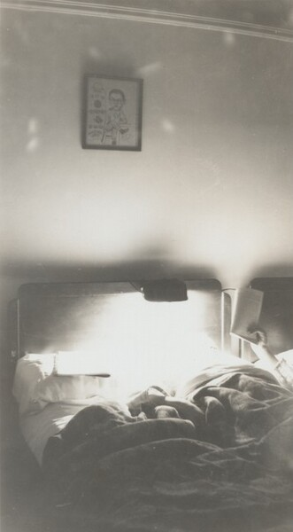 Untitled (Man reading in bed)