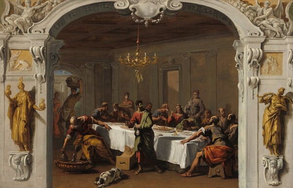 As if seen through a wide, shallow, ornamental, stone arch, seventeen light-skinned people and a dog gather around or near a long, banquet table set with plates of food in this horizontal painting. The table angles away from us so the short, right side is closest to us in the darkened room, which is lined along the wall opposite us with classical, pilastered columns and capitals. To our left, an arched doorway in the room opens to a view of a stone structure and a sliver of blue sky. A gleaming, gold candelabra with curving arms hangs over the table from a coffered, possibly wooden ceiling. The table is covered with a white cloth. Men crowd around the short ends and the long side of the table opposite us. In pairs and trios, the men converse or look towards a man with light radiating from the top and sides of his head, at the center of the far side of the table. That bearded man, Jesus, has long brown hair and points his index finger upwards with his right hand, on our left. The other men at the table wear robes and tunics in earthy sage green, tan and chocolate browns, or slate blue. A portly man standing behind Jesus stands with a cloth draped over one forearm and the opposite hand on hip, looking toward the table. Another, cleanshaven man stands holding a large platter at the far corner of the table, and two people, perhaps a man and woman, appear to be walking away from the table but look back over their shoulders to our left. On the long side of the table, closer to us, a man to our left, balding with a long gray beard, sits on a narrow, bench-like seat and twists to pick up a jug from a large vessel on the floor. The final man stands near an overturned seat as he turns his back on the table. He gestures forward, to our left, with one hand as he looks back over his opposite shoulder. A white dog with brown spots lays chewing on a bone, near the overturned seat. The highly decorated wide archway through which we see the scene seems to be carved from white marble