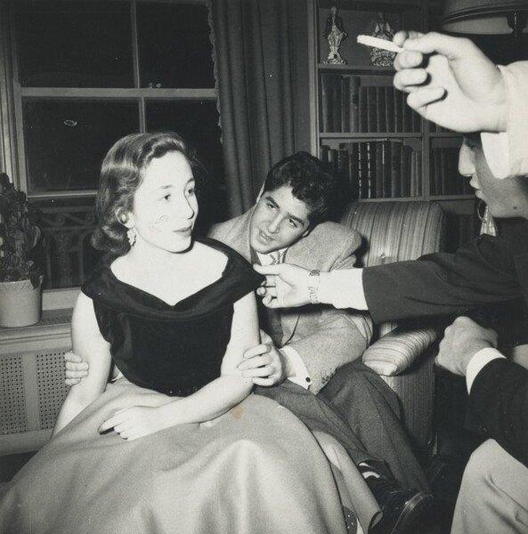 Untitled (Woman and three men at a party)