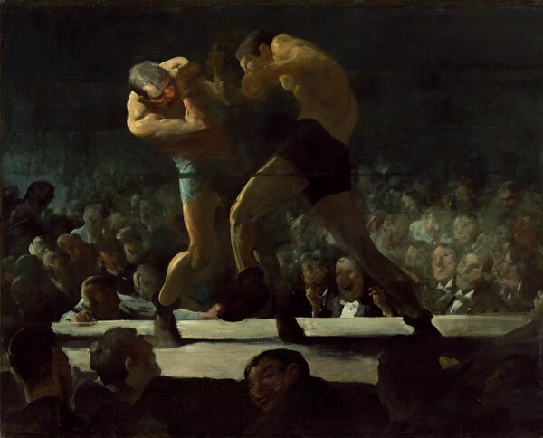Two white men wearing brief-like shorts, shoes, and boxing gloves curl towards each other as they box in the middle of a boxing ring. We seem to float slightly above the heads of the crowd below and around us. The platform of the boxing ring comes about a quarter of the way up the canvas so the boxers themselves nearly brush the top edge of the composition. The boxer on our left, in light blue shorts, curves to his side as he dips his head and right shoulder towards us in a defensive position, arms shielding his face. To our right and in the center of the composition, the opponent, in dark shorts, is shown in mid-punch with his left leg raised to step forward. His back curves like a comma as his right arm comes forward with the punch. Bright light, like a spotlight, illuminates the men from our left so even the right sides of their bodies are lost in shadow. The crowd around us is backlit but one grinning man turns to look over his shoulder towards or at us. The arena across the boxing ring is also plunged into deep shadow, so only the faces in the first few rows are visible before being swallowed in darkness. In fact, the top third of the canvas behind the boxers is black. The faces of the men in the crowd across from us are loosely painted, sometimes with only a few strokes to capture features. Individual features are mostly obscured but one face near the center, between the legs of the attacking boxer, is split wide in an exaggerated grin. That man wears a white tuxedo shirt and black jacket, and raises both hands, as if ready to light a cigar.