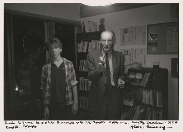 Rudi DiPrima & William Burroughs with his cigarette lighter gun -- Varsity Townhouse? 1984 Boulder, Colorado.