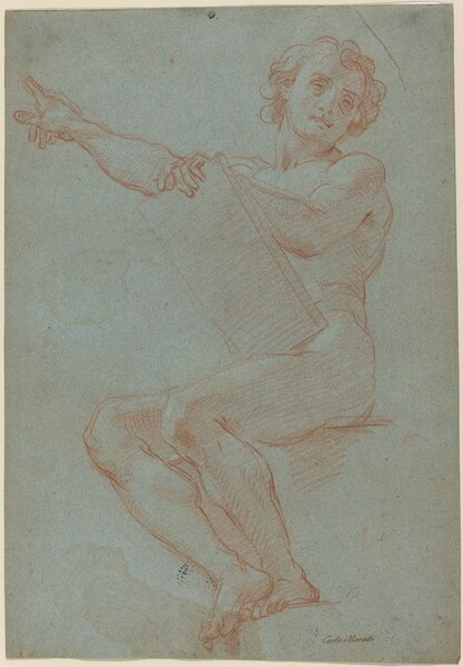 A Seated Man Holding a Tablet