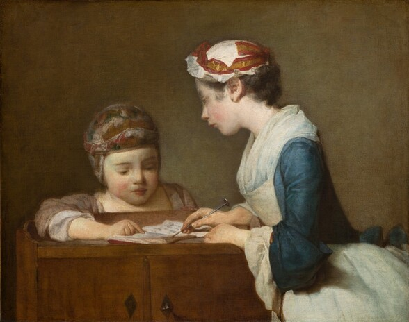 An older girl and a younger child, both with pale skin, bend toward each other as they look at a book spread open on a wooden cupboard in this nearly square painting. Seen from the hips up to our right, the girl leans over the cupboard with her body facing our left in profile. She looks at the child peering over the low ledge at the back of the cupboard with her head tilted slightly in that direction. She has a straight, delicate nose, her smooth cheeks are flushed, and her rosy-red lips are pursed. Her brown hair is tucked under a bright white, ruffled cap encircled with a gold and cranberry-red ribbon. The long sleeves of the muted sapphire-blue dress seem to have been rolled back along the forearms to reveal cascading, white cuffs. A translucent white neckerchief, like a short, full scarf, is tucked into an ivory-white apron that also covers the flaring skirt. With both hands on the open book, she points to one page with a metal pointer like a knitting needle. Facing us, the smaller child looks at the book from behind the wood cupboard, eyes downcast, resting one forearm on the surface and pointing to a detail in the book. The child has delicate brows, a short, wide nose, and full raspberry-red lips are closed. The cap the child wears covers the ears and is loosely painted with a pattern of honey brown, silvery white, and slate blue. The sleeves of the nutmeg-brown are pushed back along the forearm and there are white cuffs or sleeves beneath. The cupboard has two diamond-shaped, iron-gray metal pulls in front. Light illuminating the pair from our left creates a greenish glow on the tawny-brown background behind them.