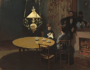 In a darkened room, two women sit at a large round table near a man who stands leaning against a fireplace mantle, all illuminated only by a soft, yellow light from a ceiling lamp hanging over the table in this nearly square painting. All the people are light skinned and have brown or dark hair. The brushwork throughout is loose, without sharp details. The brightest object in the room, the light, has a flaring shade over a spherical body, and hangs from three curling, scrolling arms. Painted in butter and golden yellows, it seems to be made from brass. The table is bare except for a white teapot and two small, white teacups on saucers near the women who sit to our right. They have turned their wooden chairs to face each other next to the table, so the one closer to us sits with her back to us. Both have brown hair pulled up in buns and they both look down at their hands. The woman farther away wears a pine-green dress with white trim at the cuffs, and the one facing away from us wears a slate-blue, high-necked dress with a white collar. The one who faces us wears holds something white in her hands, presumably needlework. A third chair at the table, closest to us, is turned towards the women, but is empty. The man has a full beard and wears a black suit. He stands in semi-darkness behind the two women next to a glowing fireplace. He leans on the mantel with his left arm, on our right, with his opposite hand on his hip. Though his eyes are deeply shaded, he seems to look down at the woman in the blue-gray dress. A large mirror over the fireplace reflects the heads of the man and the woman facing us, as well as the back of a blue-gray lidded vase on the mantel and a clock hanging on the opposite wall, out of our view. A curtain runs along the wall beyond the fireplace and is painted with the suggestion of a floral pattern in strokes of forest green, burnt orange, gray, and tan. The rest of the room is swallowed in shadowy areas of dusky browns, grays, and tans. The art