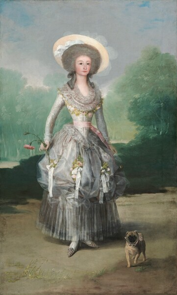 A woman with pale skin, wearing a silvery-gray dress adorned with white ribbons and light pink roses, stands looking out at us with a small, pug dog by her feet in this vertical portrait painting. The woman's body is angled slightly to our right but she looks at us with dark eyes under faint, arched brows. Her nose is rounded, her cheeks smooth and flushed, and her pale pink lips are closed. Her face is framed in a cloud of nickel-gray hair, and tendrils curl down over her shoulders. She wears a wide-brimmed straw hat with a white ribbon set on the back of her head and slightly off to one side. The bodice of her dress has a low, curving neck. This area is loosely painted to create the impression of layers of lace. A band of intertwined pale pink roses and delicately green leaves borders the outer edge of the lace. The dress has long, tight sleeves with lace at the cuffs and the notably narrow waist is tied with a blush pink ribbon. The full, silver skirt is picked up to create a row of puffs, like the top of a muffin, around her knees. Bunches of pink roses and white ribbons are nestled into the puffs, and below, the skirt falls in long, vertical pleats to her ankles. She wears white stockings and pointed, petal pink shoes. In her left arm, on our right, she holds a closed fan loosely at her side, almost lost behind the skirt. She holds a pink carnation with a full bloom and a bid on a long, curving stem in her opposite hand, by her hip. A caramel-brown pug with a black face, wearing a pink collar lined with three bells, stands facing us with one front paw lifted, to our right of her feet. The landscape is painted in tones of mint and sage green for grass beneath trees enclosing the space the woman stands in, sandy brown for the ground, and icy blue for the sky above.