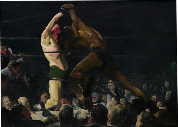 """As if seen from about the third row in a darkened arena around a boxing ring, two bare chested men, one with cream-white skin and the other with brown skin, lock arms in a boxing match in this horizontal painting. The brushstrokes are loose and visible throughout, making some details difficult to distinguish. The boxer on the left has light skin with a greenish cast, and wears drooping, forest green trunks and black shoes. He leans back on his bent right leg, closer to us, and tilts his face upwards. His mouth gapes open and his nose, chin, and neck are smeared with scarlet red, suggesting blood. His chest, arms, and legs are sinewy and muscular. His right arm is raised or pulled up overhead by the boxer to our right. Wearing dark briefs, the second boxer hunches over with head lowered toward the other man's shoulder. He surges forward onto his deeply bent left knee, closer to us, pushing powerfully off his back leg. His face is lost in shadow and his body has less detail than his opponent, though his arching back catches the light, which glints off his spine, ribs, and muscles of the shoulder. The men's bodies nearly span the height of the canvas. The black ropes of the ring pass in front of and behind the boxers and the space around the ring in the top half of the painting is nearly black. Heads and faces of the spectators in the first few rows are lit by the main event and are crowded into the bottom third of the painting. Two spectators on our far left have climbed up and lean on and through the ropes, their mouths open. The crowd, which appears to be all lighter-skinned men and boys, are painted loosely but their mouths widen in toothy grins or gape in awe or disappointment. The artist signed the work in yellow letters against black in the lower right corner: """"Geo Bellows."""""""