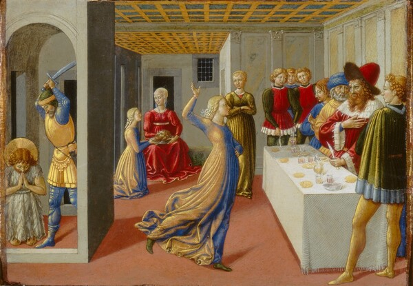 A woman with blond hair dances in the center of a room containing a group of people clustered around a banqueting table to our right with a small, enclosed space occupied by a kneeling man and executioner to our left in this horizontal painting. All the people have pale skin. The ceiling is made up of blue squares encased in a gold grid that recedes to the back, stone wall of the room. The woman's dress seems to be made of fabric that looks vivid royal blue or butter yellow, depending on how the light hits it. Facing our right in profile as she dances, she steps forward onto her left foot, raises her right foot behind her, and holds her right arm aloft. Four men wearing crimson red, pine green, yellow, or bright blue robes or tunics and stockings stand behind the long table set along the wall to our right. A bearded man at the center of the table wears a red hat and fur-lined red robe. He touches his right hand to his chest and holds a knife on the table in his right hand as he looks at the dancing woman. Glasses, dishes, and bowls are arrayed along the table, which is draped with a white tablecloth. A trio of blond, curly-haired, clean-shaven men and a woman with her arms crossed across her chest stand at the far, narrow end of the table, on the other side of the room. Within an alcove at the back of the room, the dancer appears again, kneeling before a seated woman wearing a ruby red dress. The dancer holds or gestures towards a silver plate holding the severed head of a bearded man with brown hair that rests in the seated woman's lap. The left third of the painting is taken up with an enclosure, a tiny room set like a tall, stone box within the larger room. Through an arched opening, a haloed man wearing an ivory colored garment that resembles fur kneels facing us, his head bowed over his hands in prayer. He is the same man as the one beheaded and presented on the plate in the background. A man wearing yellow and blue armor raises a sword over his head, preparing