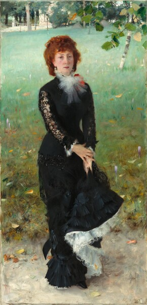 """A slender woman with a pale pink complexion and reddish, auburn hair stands facing and looking at us on a grassy lawn, wearing a long black dress in this vertical portrait painting. She stands with her body angled slightly to our right but turns to look at us with heavy-lidded, hazel eyes under pointed brows. She has a narrow face, a straight nose, and her somewhat full, pink lips are closed. Her cheeks are lightly flushed and she has a cleft in her chin. Her copper-colored, curly hair is pulled back, and bangs sweep across her forehead. Her black dress has a fitted bodice and the long, narrow skirt ends in layers of ruffles at the hem. A spray of white fabric, perhaps taffeta, is tied in a flaring bow at her neck, partially overlapping a tomato-red object, perhaps a flower or corsage, on her left shoulder, farther from us. The tight sleeves of her dress are black lace, and the cuffs are lined with more sprays of white. She holds up her skirt with both hands, close to her left thigh. Where the hem is lifted, the layers of white fabric underneath are exposed, creating an S-shape that curves down to her feet. The sheen on the layers of ruffles suggest that the black skirt, at least, is made from silk. She wears jeweled rings on the fourth finger of each hand and dangling earrings. She stands on an oyster-colored ground, probably a walking path, in front of a lawn that fills most of the background behind the woman. Touches of yellow and pale purple suggest flowers in the lawn, which fades from a tawny green close to us to mint-green in the distance. The carpet of the lawn is broken only by a birch tree near the upper right corner, beyond the woman. A spray of leaves, perhaps from a tree just outside the composition, dips into the scene at the upper right as well. Some trees and a white, stone structure with steps and a balustrade line the top edge of the composition. The artist inscribed the work with brown script in the lower right corner, where it reads: """"John S. Sar"""