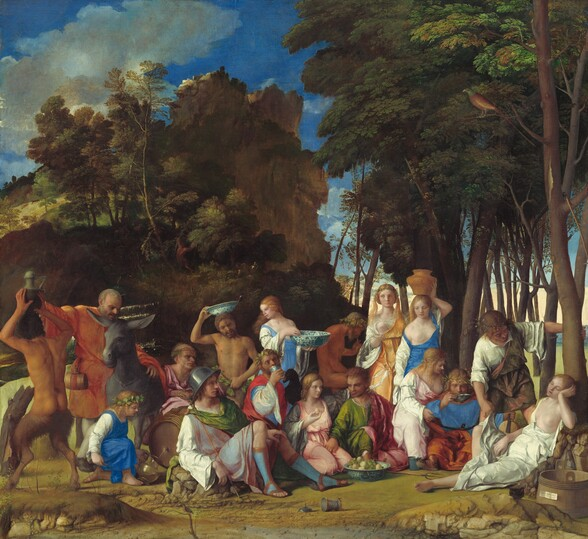 """Six women, eight men, two satyrs, and one child gather in pairs and trios in a loose row that spans the width of this painting, against a landscape with craggy rocks, cliffs, and trees in this nearly square painting. Most of the people face us, and the men, women, and child have pale skin while the two satyrs, who have men's torsos and furry goat's legs, have darker, olive complexions. Most of the men wear voluminous, knee-length togas wrapped in short robes in shades of white, topaz blue, grass green, coral orange, or rose pink. Most of the women wear long, dress-like garments in tones of shell pink, apricot orange, or lapis blue over white sleeves. For all but one woman, their garments have fallen off one shoulder to reveal a round, firm breast. Several objects are strewn on the rocky, dirt ground in front of the group, including a wide, wooden bucket with a piece of paper affixed to its front to our right, a glass goblet, a pitchfork, a large blue and white ceramic dish filled with grapes and small, yellow fruits, and an overturned cup near the center. Cliff-like, craggy rocks rise suddenly behind the group to our left, filling much of the sky opposite a tall grove of leafy, dark green trees to our right. A few puffy white clouds float across the vivid blue sky. The slip of paper on the barrel has been inscribed, """"joannes bellinus venetus p MDXIIII."""""""