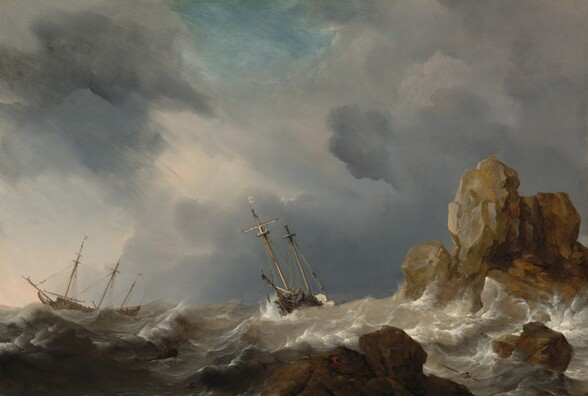 Amid the white crests of gray, churning waves, two masted ships tip wildly near a rocky outcropping beneath slate-gray and lavender-purple clouds in this horizontal landscape painting. The horizon comes a quarter of the way up the painting, and the ships are outlined against the clouds, which sweep across the sky from the lower right to the upper left corner. A patch of cerulean blue sky shines through at the top center of the painting. The long side of the three-masted ship to our left faces us and flags, possibly white with red stripes, fly from two of its masts. The ship at the center of the painting is angled toward us and a single white flag with a red cross flies from one of its two masts. Tiny in scale, people are gathered on the decks and climb the rigging alongside the masts. On the boat at the center, one person hovers overboard, perhaps holding onto a rope or shown falling to the sea. Foamy waves lap at the tall, jagged rock formations to our right, which jut out of the ocean like teeth. The largest boulder, near the right edge of the painting, is painted with tones of golden tan and silvery gray, suggesting it catches sunlight. The lower rocks, closer to us, are in shadow and painted coffee brown and iron gray. Upon closer inspection, two people climb onto the jagged rock closest to us. More scrutiny reveals several people in a rowboat and two men in the water around the rocks. A few birds, miniscule against the waves, fly over the rocks.
