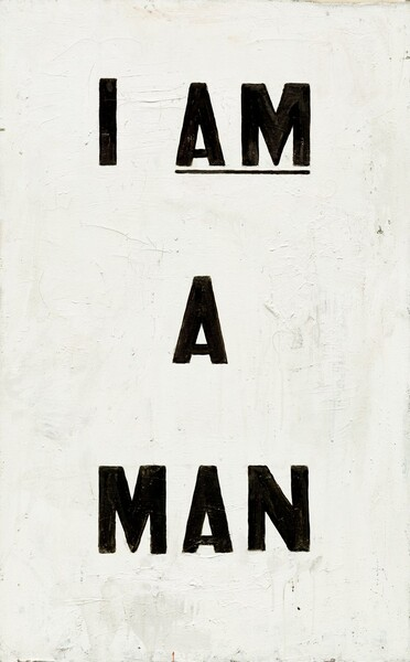 """The words """"I AM A MAN"""" are painted in all capital, bold black letters against a white ground in this vertical painting. The words are spaced so they take up most of the composition, with """"I AM"""" on the top line, """"A"""" at the center of the composition, and """"A MAN"""" at the bottom. """"AM"""" is underlined. The white paint is thickly applied and brushstrokes, drips, and cracks are visible on the surface. A sliver of raw, off-white canvas is visible at the top right corner."""