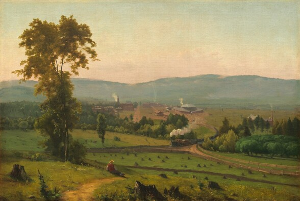 """As if from a hillside, we look across and down into a valley with a person sitting near a tall tree us and a train puffing smoke beyond, all enclosed before a band of mountains in the distance in this horizontal landscape painting. Closest to us, several broken, jagged tree stumps are spaced across the painting's width. A little distance away, the person dressed in a yellow, broad-brimmed hat, red vest, and gray pants reclines propped on his left elbow near a walking path beside a tall, slender tree with golden leaves to our left. The green meadow stretching in front of him is dotted with tree stumps cut close to the ground. Beyond the meadow, puffs of white smoke trail behind a long steam locomotive that crosses a bridge spanning a tree-filled ravine, headed to our left. The ravine creates a diagonal line across the canvas, moving subtly away from us to our left. The train has climbed out of the valley, away from a cluster of brick-red buildings. The most prominent structure is a train roundhouse, a large building with a high, domed roof to the right of the tracks. Smoke rises from chimneys on long, warehouse-like buildings, and a steeple and smaller structures suggest a church and homes to our left. Densely spaced trees along the left edge of the canvas suggest a forest. Hazy in the distance, a row of mountains lines the horizon, which comes about halfway up the composition. The sky above deepens from pale, shell pink over the mountains to watery, pale teal above. The artist signed the work in tiny letters in the lower left corner: """"G. Inness."""""""