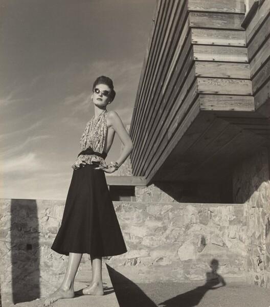 Model outside the Rose Pauson House