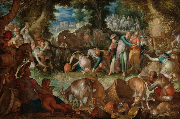 A group of light-skinned people and animals gather in an oval ring around a shallow pool in a wooded landscape in this horizontal painting. Deep in shadow but closest to us, animals, objects, and people create a continuous band in the foreground. From left to right is a horse, a reclining woman and small child, a goat and nude child, a dog sniffing at a pile of crockery, baskets, and metal pans and dishes, a cat lapping from a shallow pewter dish, and a young man drinking from a dish or large shell in the lower right corner. Beyond and to our right, an older man with gray hair and beard and wearing turquoise, pink, and blue robes taps an outcropping of rocks with a thin rod. Water gushes in thin streams from the outcropping into the pool below. The bearded man is surrounded by several standing men and women. Men, women, and children bend over the edge of the pool around its perimeter, filling or drinking from jugs, dishes, and pans. Most of the men wear long robes and some wear turbans, and the women wear long dresses or robes in teal, aquamarine, shell pink, pale yellow, and ivory. Trees enclose this group to the left and center of the painting, and another band of dozens of people, animals, and wagons line the horizon in the distance. They are painted in pale gray, blue, pink, and white. The horizon line comes three quarters of the way up the composition and glimpses of vibrant blue sky and white clouds are seen through breaks in the trees. Light glints distinctively off of clothing, smooth skin, the fur of the animals, and especially the metalware in the foreground to give the painting a glimmering, almost glossy look.