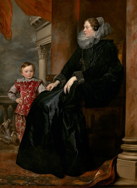 A woman wearing a voluminous black dress with a wide, ruffled collar sits holding the hand of a young boy, who stands next to her, in this full-length, vertical portrait painting. The woman sits with her body in profile facing our left, and she looks in that direction. The boy stands at her feet, behind her legs to our left, looking out at us. Both have pale, peachy skin with rosy cheeks, dark blond hair, and brown eyes. The woman's hair is pulled back and covered with pearls, and a few short tendrils curl around her face. Her long black dress has puffed, black-on-black brocade sleeves and the skirt is cut with short, decorative slits. The skirt has a sheen where the light falls, suggesting it is silk. Her wide, stiff, ruffled collar is pleated into a figure-eight pattern around her neck and a thick gold chain loops over one shoulder to the opposite hip. The sleeves have wide, ruffled cuffs and she wears a gold ring with a slate-blue gemstone on the pinky finger of her right hand, closer to us. The boy's small fingers wrap around the woman's elegant right hand, farther from us. His body faces us and his other hand rests on his hip. His straight hair falls across his forehead and to his ears. His richly patterned suit has a crimson-red leafy pattern against gray satin, and the sleeves are also nickel gray. A wide, lace-trimmed collar rests along his shoulders. A dog frolics behind the boy, looking up at him with mouth open and tongue hanging out. The woman's chair is framed by two stone columns streaked with rust red and taupe, and they extend off the top edge of the composition. A balustrade runs behind the boy along an opening beyond. The top corner of an entablature or lintel supported by columns is visible against a steel gray, cloudy sky. A red drape flutters above the people, along the top edge of the canvas, and the red-and-brown woven carpet below the pair kicks up at the base of the column closer to us.