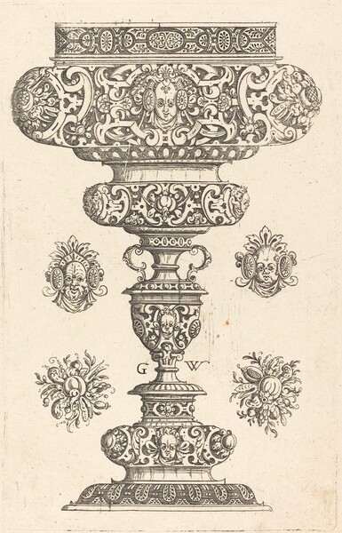 Goblet, rim decorated with masque and bouquet of fruit