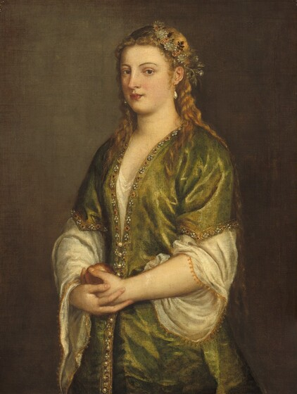 Seen from about the hips up against a sable-brown background, a pale-skinned woman stands cradling an apple with both hands at her waist in this vertical portrait painting. Her body and face are angled to our left but she looks out at us from the corners of her eyes. She has dark brown eyes under curving brows, a straight nose, smooth cheeks, and her coral-red, heart-shaped lips are closed. A crown of parchment-white and rust-orange flowers with sage-green and brown leaves sits akimbo, close to the ear we can see, over her honey-brown hair, which falls over her shoulders and down her back to her waist. Teardrop-shaped pearls hang from her ears. She wears a sea-green gown with elbow-length sleeves over an eggshell-white garment, which has voluminous sleeves edged with gold. The green garment is lined with pearls, jewels, and gold embroidery around the hem of the sleeves and down the front. The muted red apple rests in one hand, which is cupped in her other hand at her waist. The woman is lit from our left in a warm glow against the brown background.