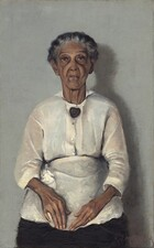 """In this vertical portrait, an elderly woman with brown skin, wearing a blouse, apron, and skirt is painted with a limited palette of grays, browns, black, and whites. Her head, torso, and lap nearly fill the composition. She is shown straight-backed against a neutral gray background, facing and looking at us with her hands resting in her lap. Her wavy, iron-gray hair is parted in the center and pulled back from her face. Her eyebrows are slightly raised and her face is deeply lined down her cheeks and around her mouth. She wears a heart-shaped brooch with a red stone at its center at her neck and a gold band on her left ring finger. The light coming from our left casts a shadow against the wall to our right. The artist signed and dated the painting in the lower right corner: """"A.J. MOTLEY. JR. 1922."""""""
